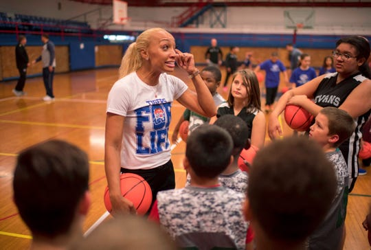 Tennessee State Women's Basketball Coach Jessica Kern inspires the youngsters at the Ohio Valley Conference Basketball Youth Clinic at the Downtown YMCA Monday afternoon.