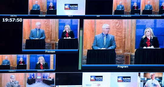 Stephen Folz debates Indiana State Representative Wendy McNamara at the WNIN studio Monday night.