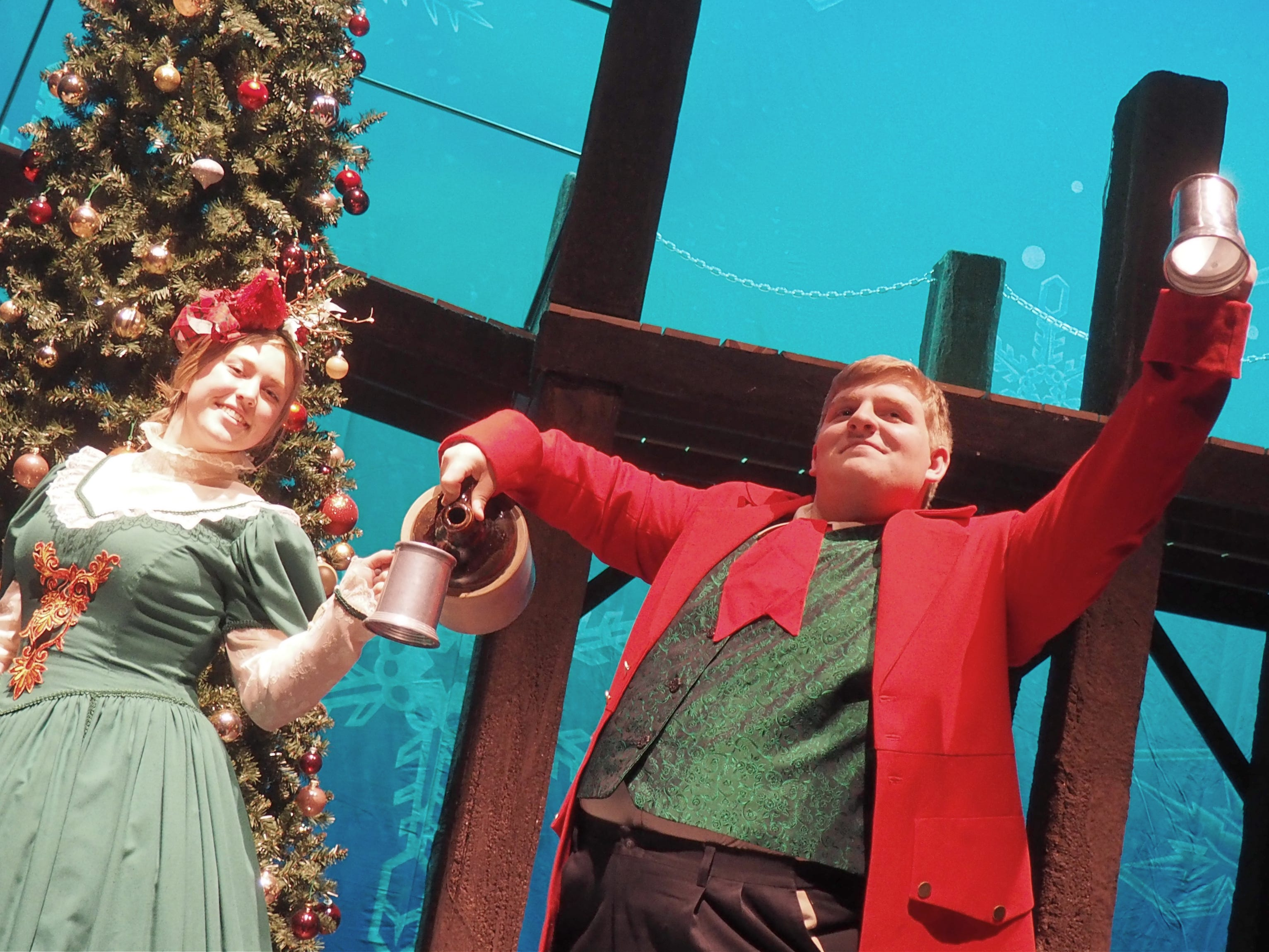"""Mrs. and Mr. Fezziwig, played by Britt Rasner and Joey Gutzmann, toast to the holiday season during rehearsals Monday for """"A Christmas Carol,"""" which opens on Nov. 1 at the Fond du Lac High School Performing Arts Center."""