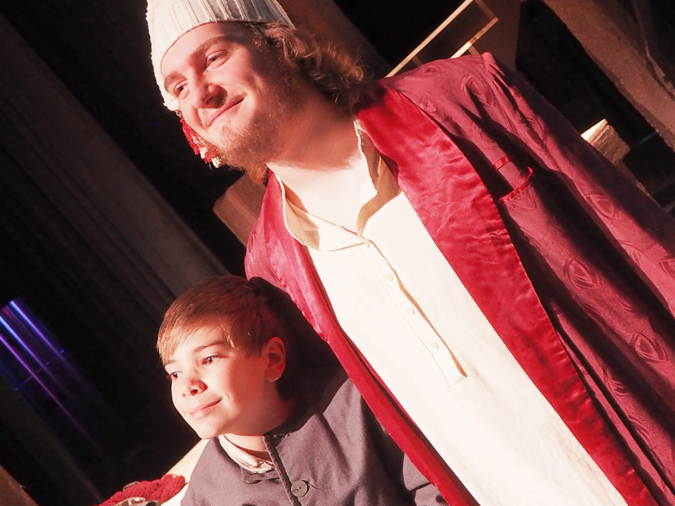 "Jerome Poltrock, playing Ebenezer Scrooge, embraces Tiny Tim, played by Gavin Twohig, during rehearsals Monday for ""A Christmas Carol,"" which opens on Nov. 1 at the Fond du Lac High School Performing Arts Center."