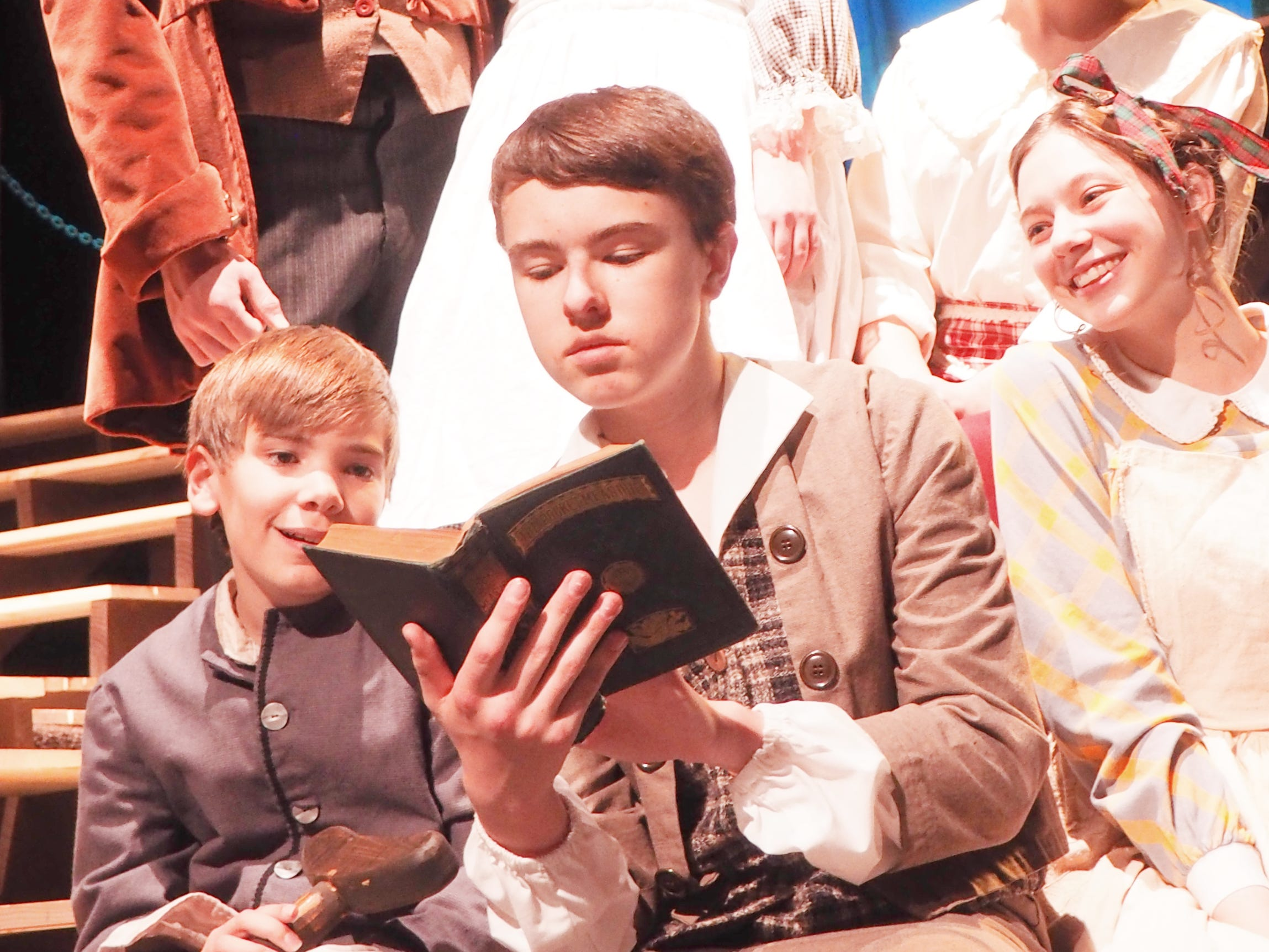 "The Cratchit Family reads from the Bible during rehearsals Monday for ""A Christmas Carol,"" which opens on Nov. 1 at the Fond du Lac High School Performing Arts Center."