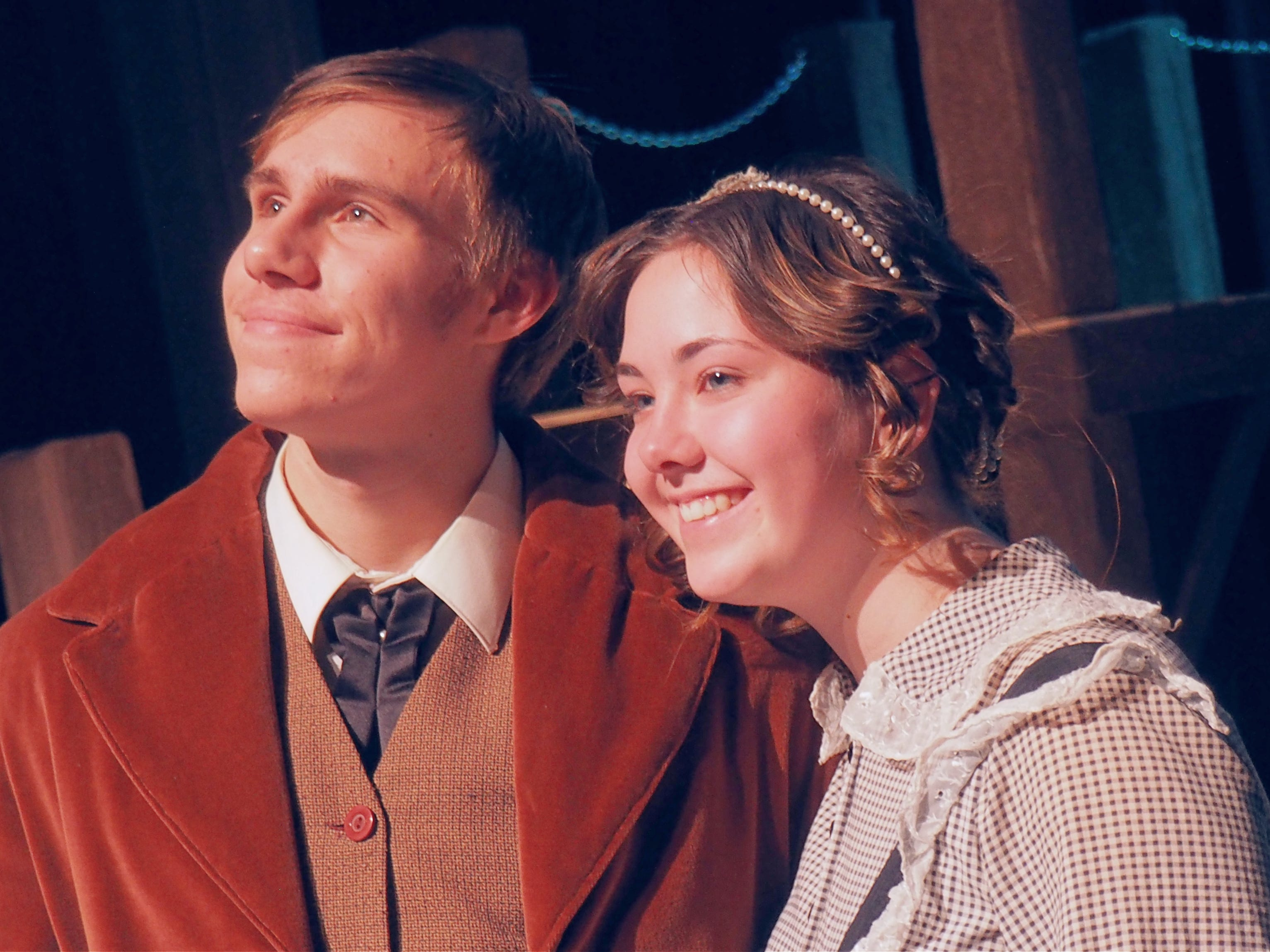 "David Bonlander, left, and Kennedy Kramer portray Mr. and Mrs. Cratchit during rehearsals Monday for ""A Christmas Carol,"" which opens on Nov. 1 at the Fond du Lac High School Performing Arts Center."