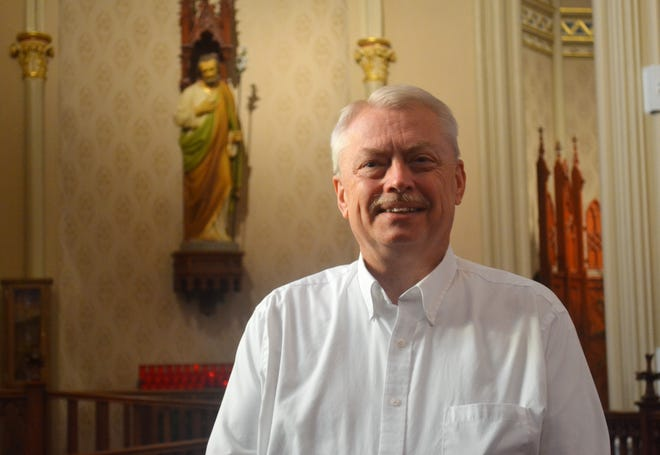 Deacon Mel Shell is Director of Faith Formation at St. Joseph and St. Ann catholic churches. Here, he stands at St. Joseph, which will celebrate All Saints' Day on Nov. 1, All Souls' Day on Nov. 2, and the novena to Our Lady of Guadalupe on Dec. 4-12.