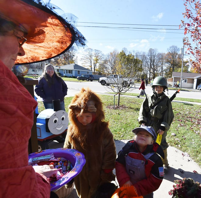 Leo, Owen and Matt Machut arrive with Thomas the Tank Engine and their mother, Casie Machut, at Vicki Anderson's house in Casco, where Anderson was handing out trick-or-treat candy last year.