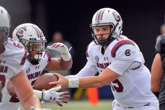 South Carolina Gamecocks quarterback Jake Bentley (19) hands off to running back A.J. Turner (25) against the Vanderbilt Commodores.