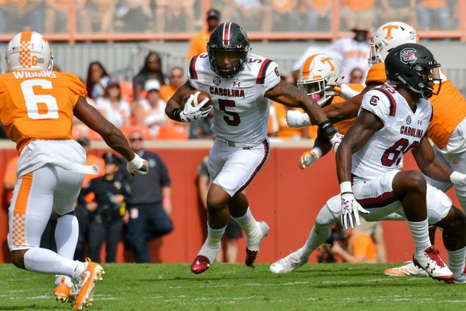 Oct 14, 2017; Knoxville, TN, USA; South Carolina Gamecocks running back Rico Dowdle (5) runs with the ball against the Tennessee Volunteers during the first quarter at Neyland Stadium. Mandatory Credit: Randy Sartin-USA TODAY Sports
