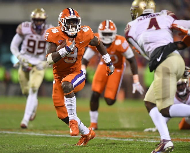 Clemson running back Travis Etienne (9) carries against Florida State during the 4th quarter on Saturday, November 11, 2017 at Clemson's Memorial Stadium.