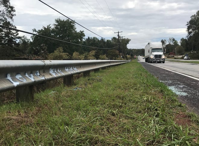 "With shattered glass and spray paint that reads ""Love Fly High,"" the side of U.S. 25 in Travelers Rest shows where the latest DUI-related fatal crash occurred in Greenville County. Jessica Adams, 17, was killed Oct. 13. The driver, Madison Bagwell, 19, was charged with DUI."
