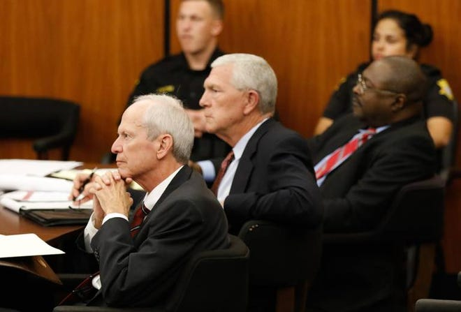 Former state representative Jim Harrison, sits Monday, Oct. 22, 2018, with his attorney's Hunter Limbaugh, center, and Reggie Lloyd at the start of his trial on charges of misconduct and perjury.