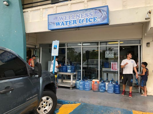 Guam residents get water in Yigo before Typhoon Yutu arrives in Marianas