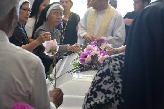 Family and fellow Sisters of Mercy say goodbye to Sr. Mary Jeanette Leon Guerrero Oct. 23 at the Pigo Cemetery.