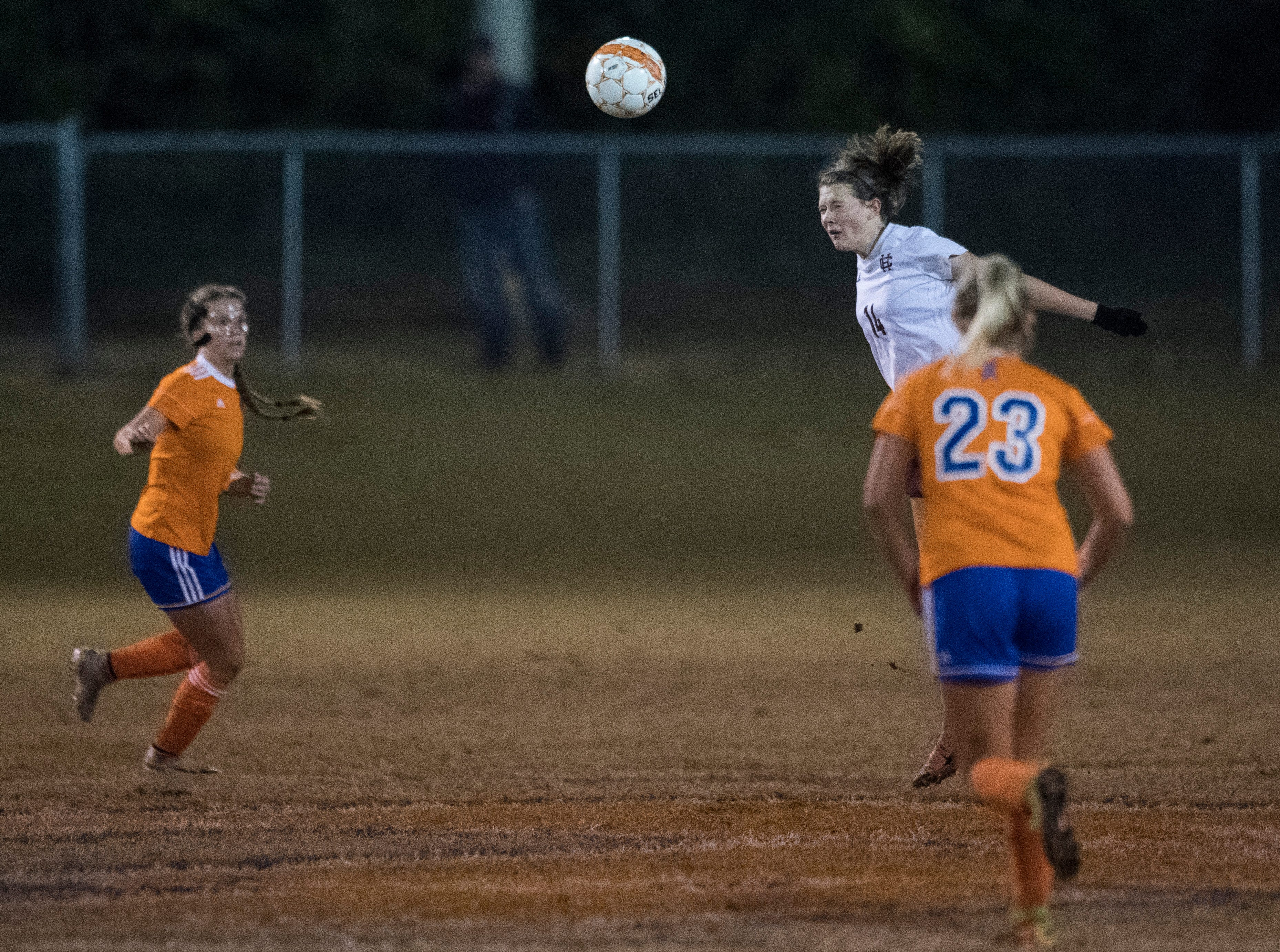 Henderson's Kayla West (14) heads the ball during the first round of the KHSAA state tournament at Marshall County High School Monday, Oct. 23, 2018.