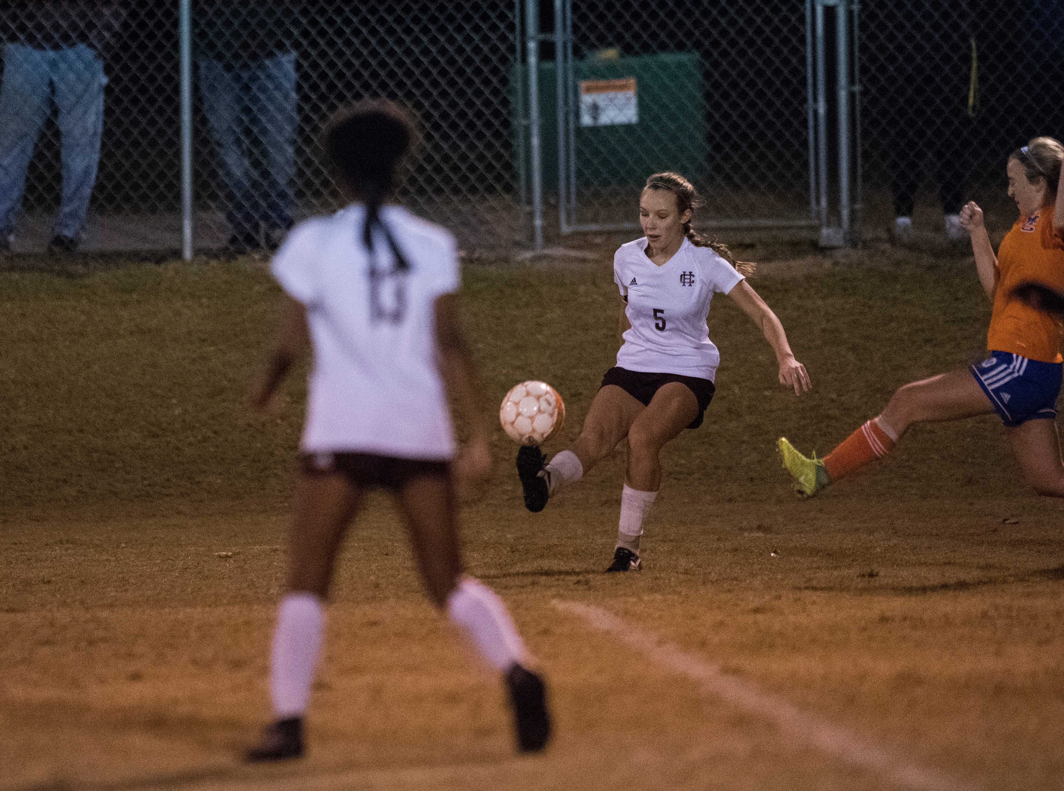 Henderson's Maddie Griggs (5) passes the ball to Henderson's Nadia Gilbert (13) during the first round of the KHSAA state tournament at Marshall County High School Monday, Oct. 23, 2018.