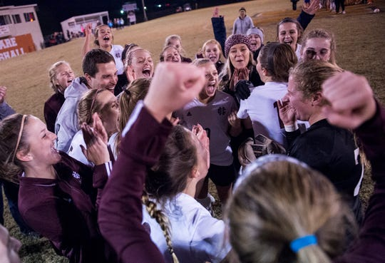 Henderson County's team celebrates its 1-0 penalty kick shootout victory over Marshall County Monday in the first round of the KHSAA state tournament at Marshall County High School.