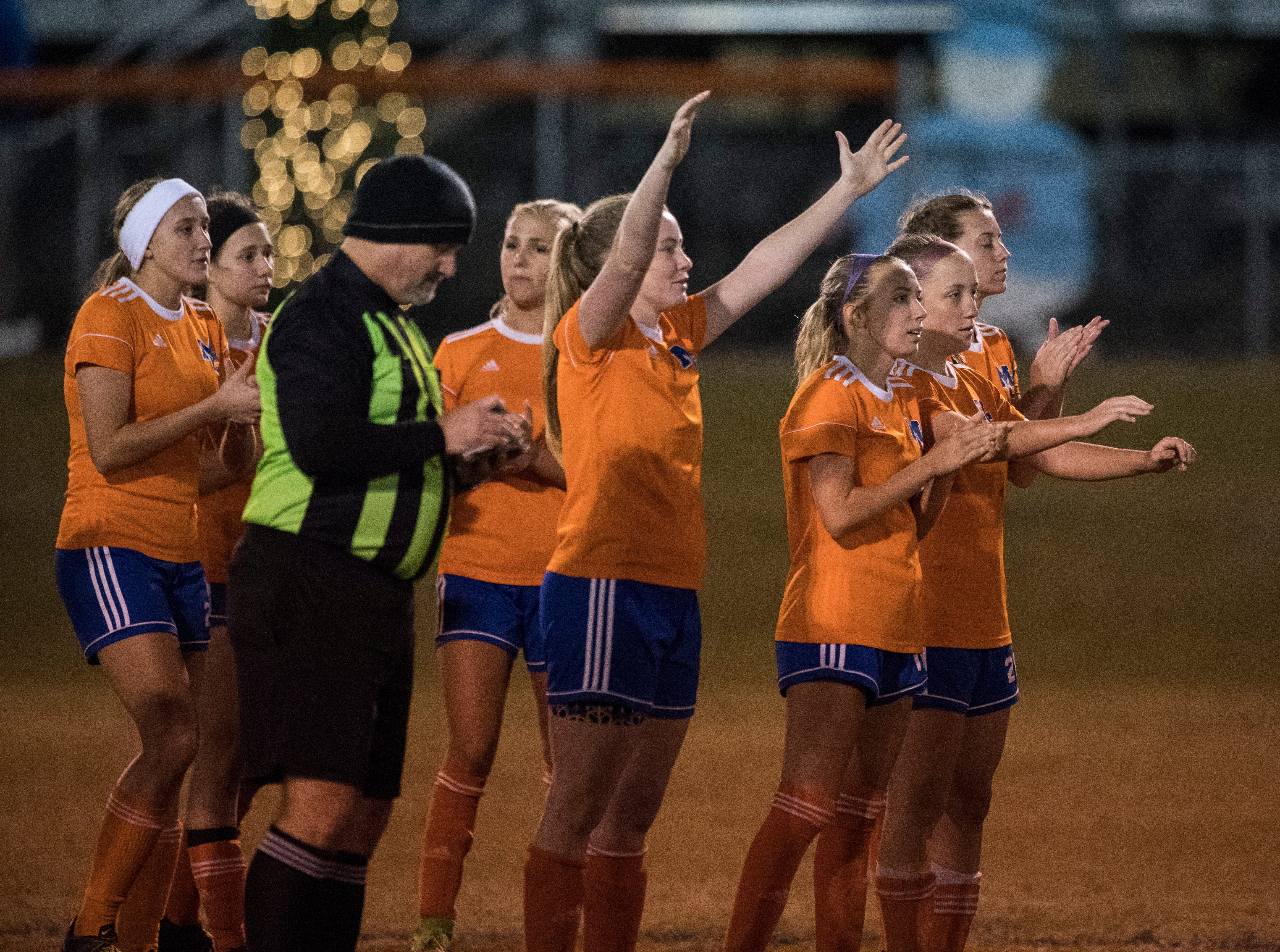Marshall County Lady Marshals celebrate after making a penalty kick in sudden death during the first round of the KHSAA state tournament at Marshall County High School Monday, Oct. 23, 2018.