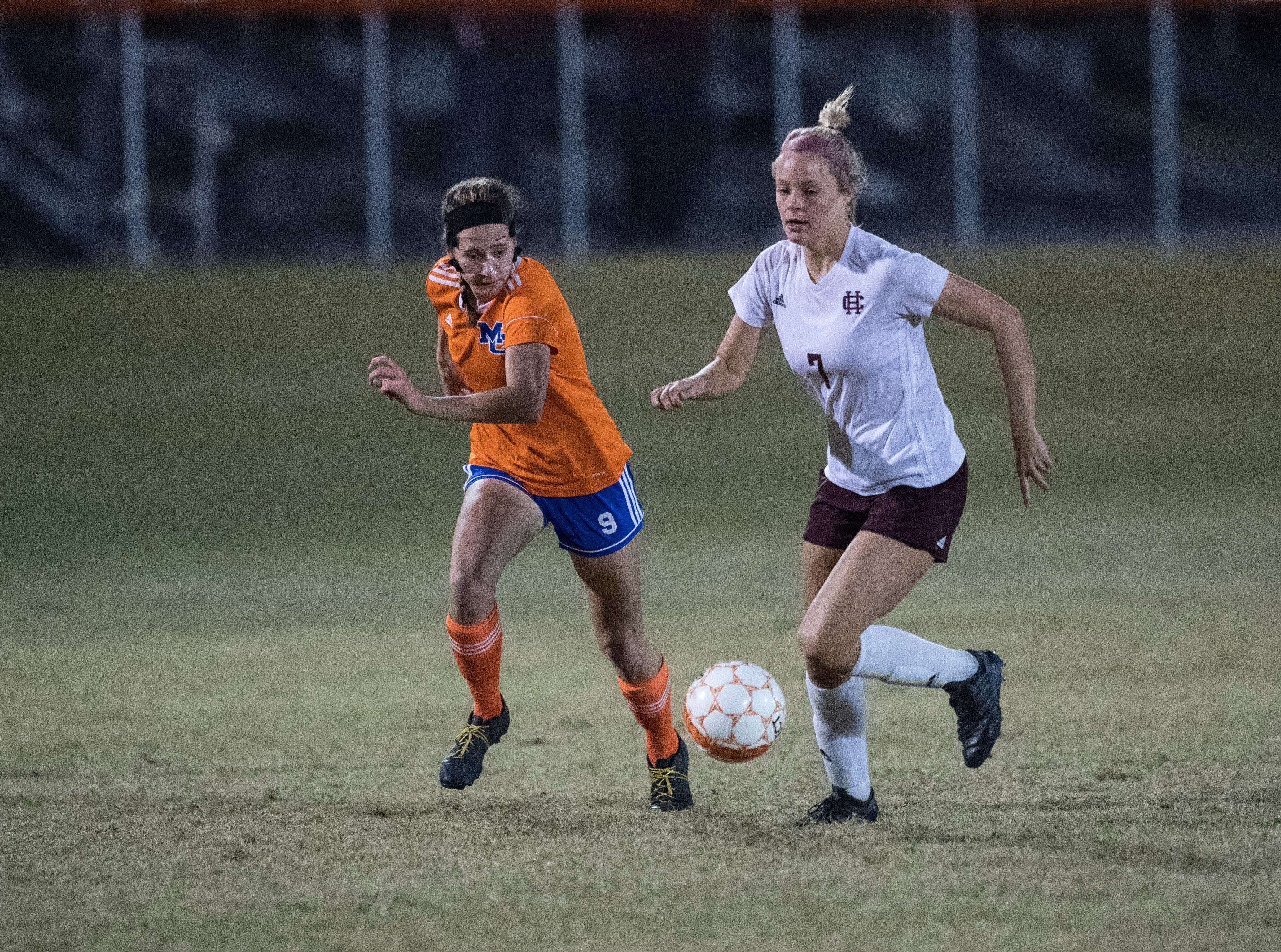 Marshall County's Hanna Holsapple (7) and Henderson's Carlee Crafton (7) battle during the first round of the KHSAA state tournament at Marshall County High School Monday, Oct. 23, 2018.