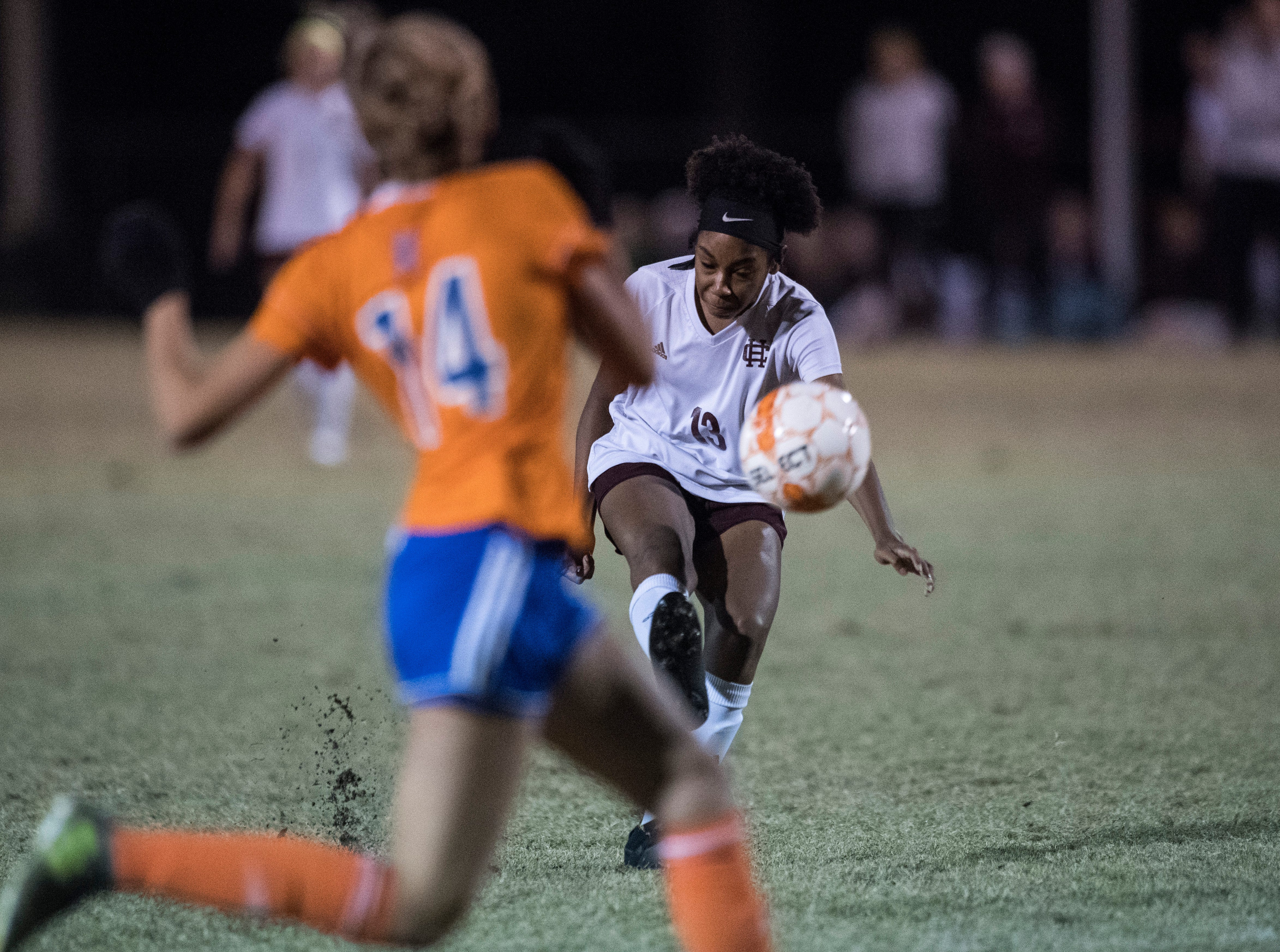 Henderson's Nadia Gilbert (13) kicks the ball towards the goal during the first round of the KHSAA state tournament at Marshall County High School Monday, Oct. 23, 2018.