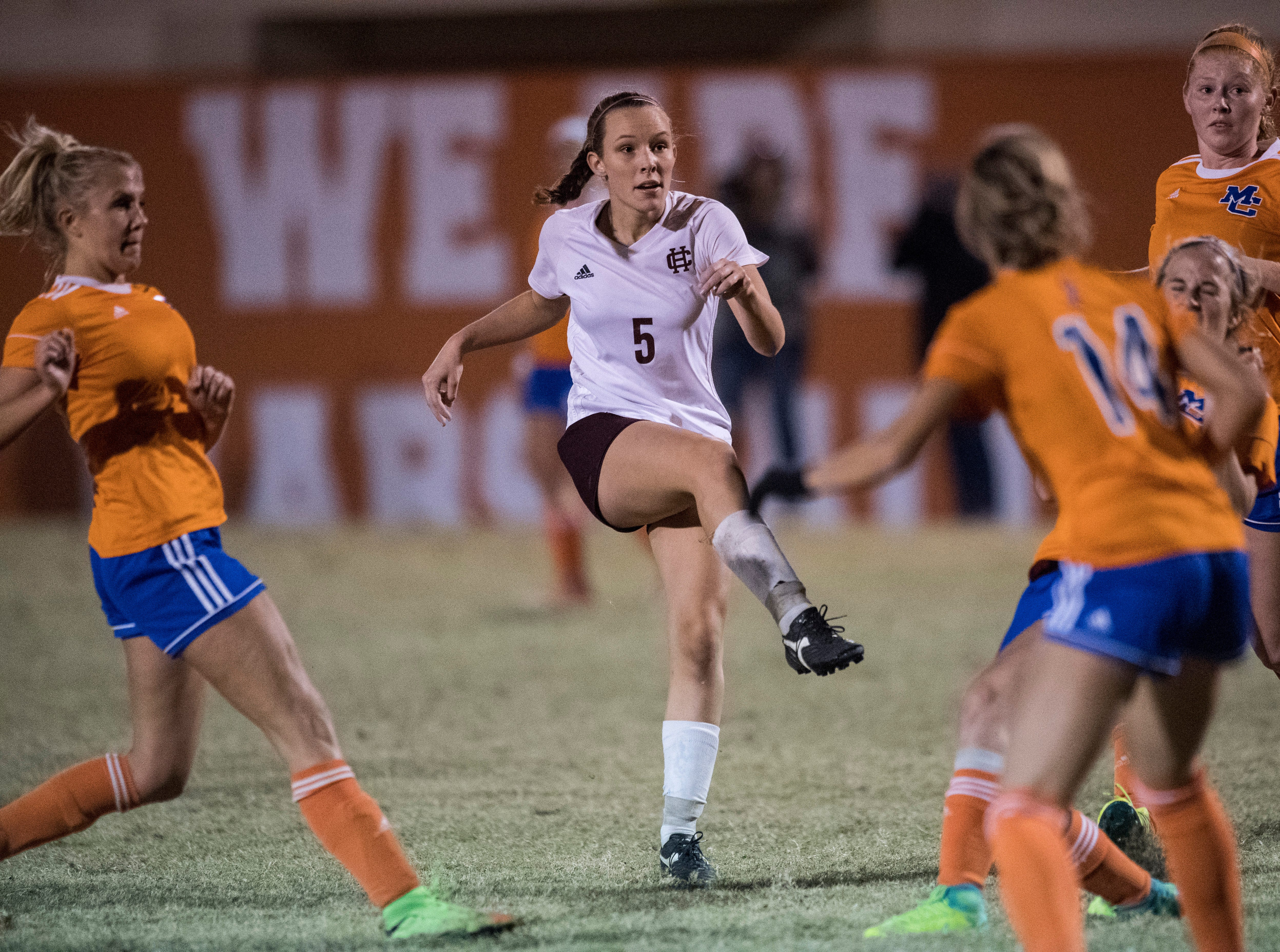 Henderson's Maddie Griggs (5) kicks the ball towards the goal during the first round of the KHSAA state tournament at Marshall County High School Monday, Oct. 23, 2018.