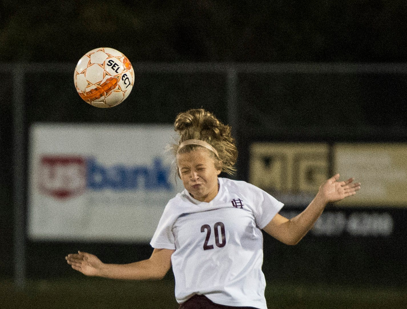 Henderson's Morgan Green (20) heads the ball during the first round of the KHSAA state tournament at Marshall County High School Monday, Oct. 23, 2018.