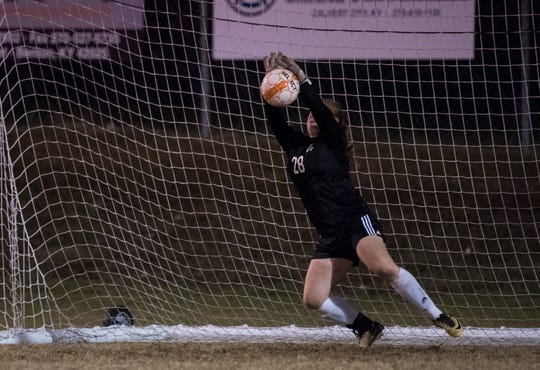 Henderson's Ashby Greenwell (28) blocks a sudden death penalty kick during the first round of the KHSAA state tournament at Marshall County High School Monday, Oct. 23, 2018.