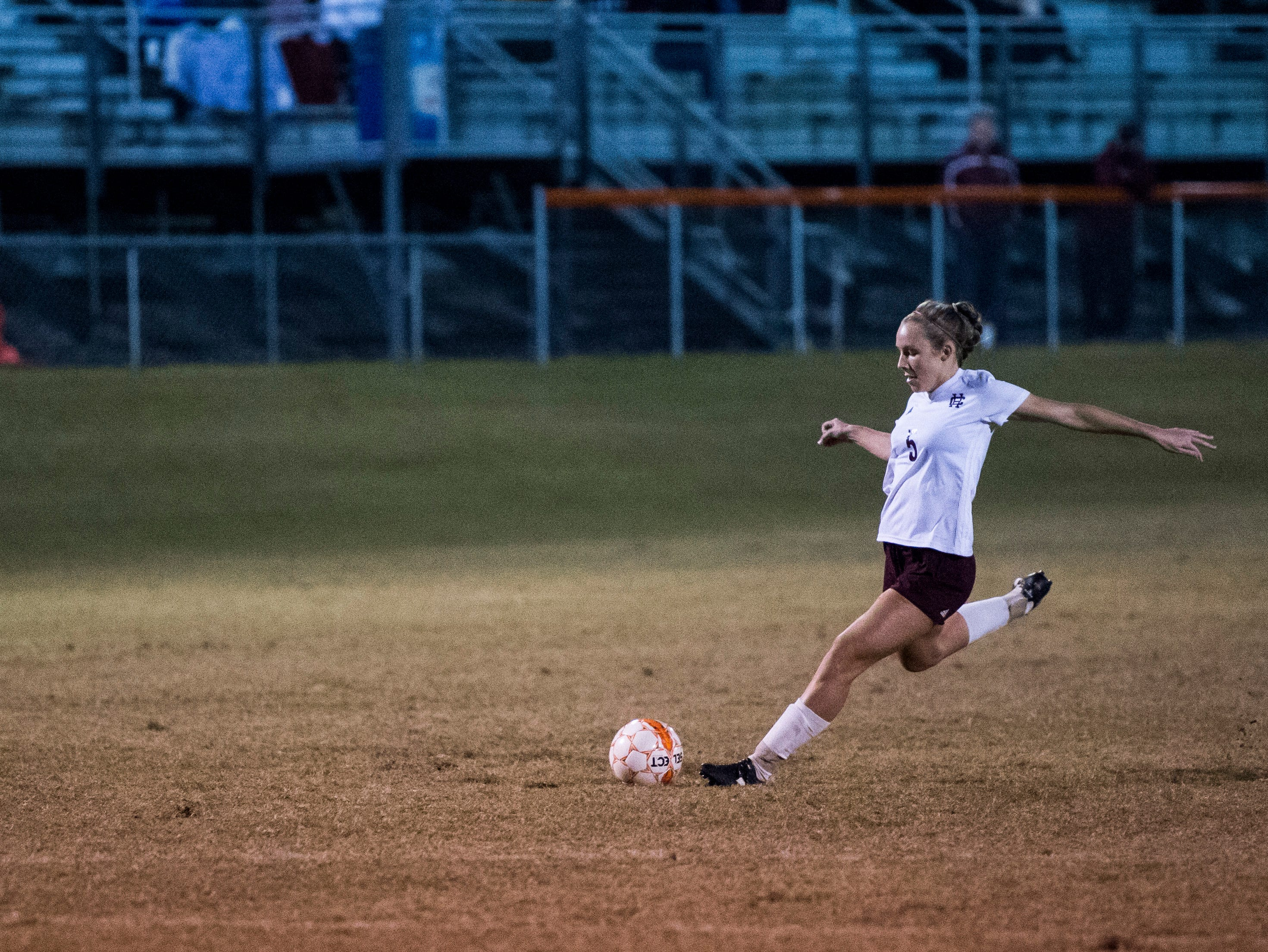 Henderson's Maddie Griggs (5) fires off a goal kick against Marshall County during the first round of the KHSAA state tournament at Marshall County High School Monday, Oct. 23, 2018.