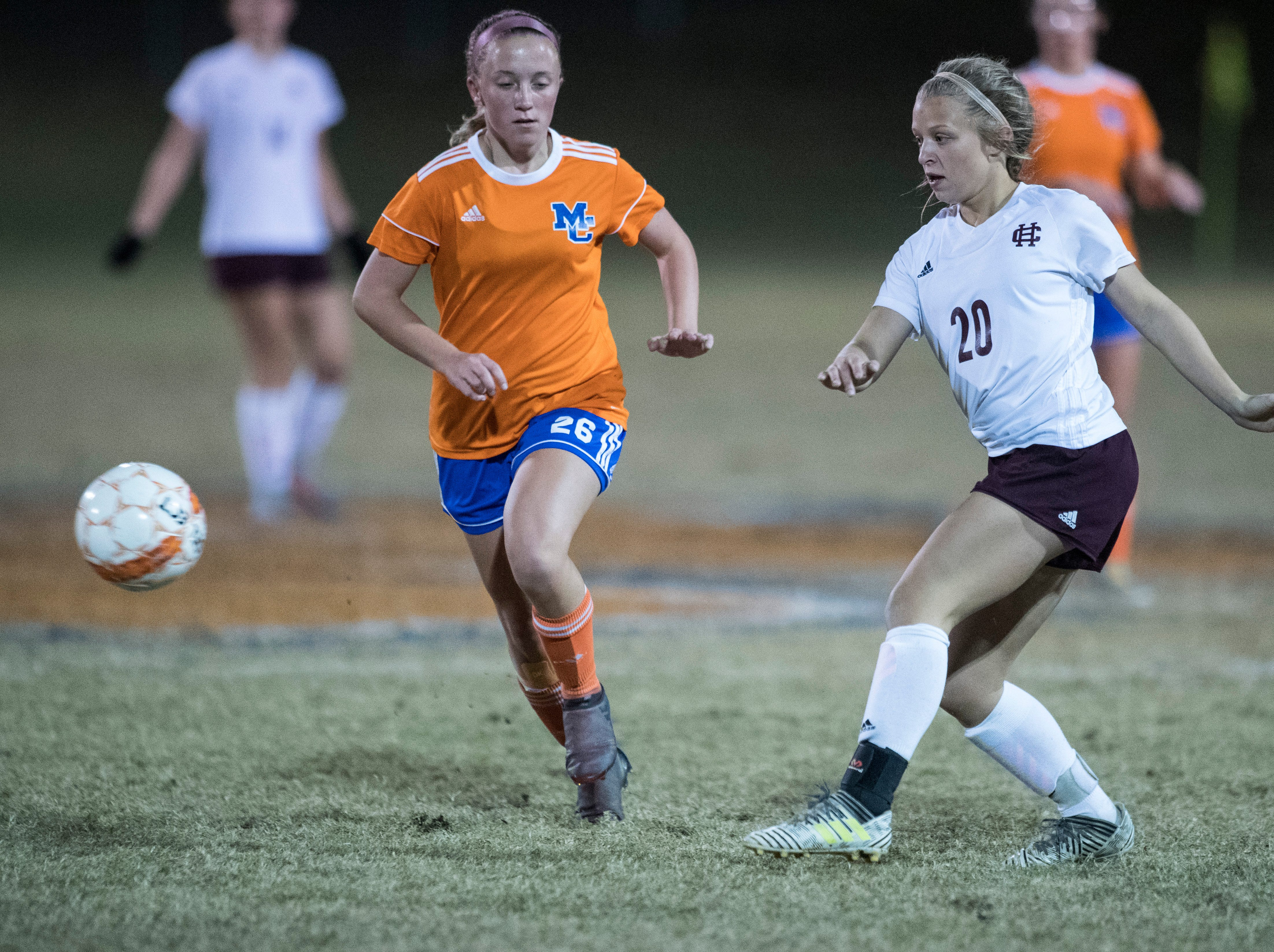 Henderson's Morgan Green (20) passes the ball during the first round of the KHSAA state tournament at Marshall County High School Monday, Oct. 23, 2018.