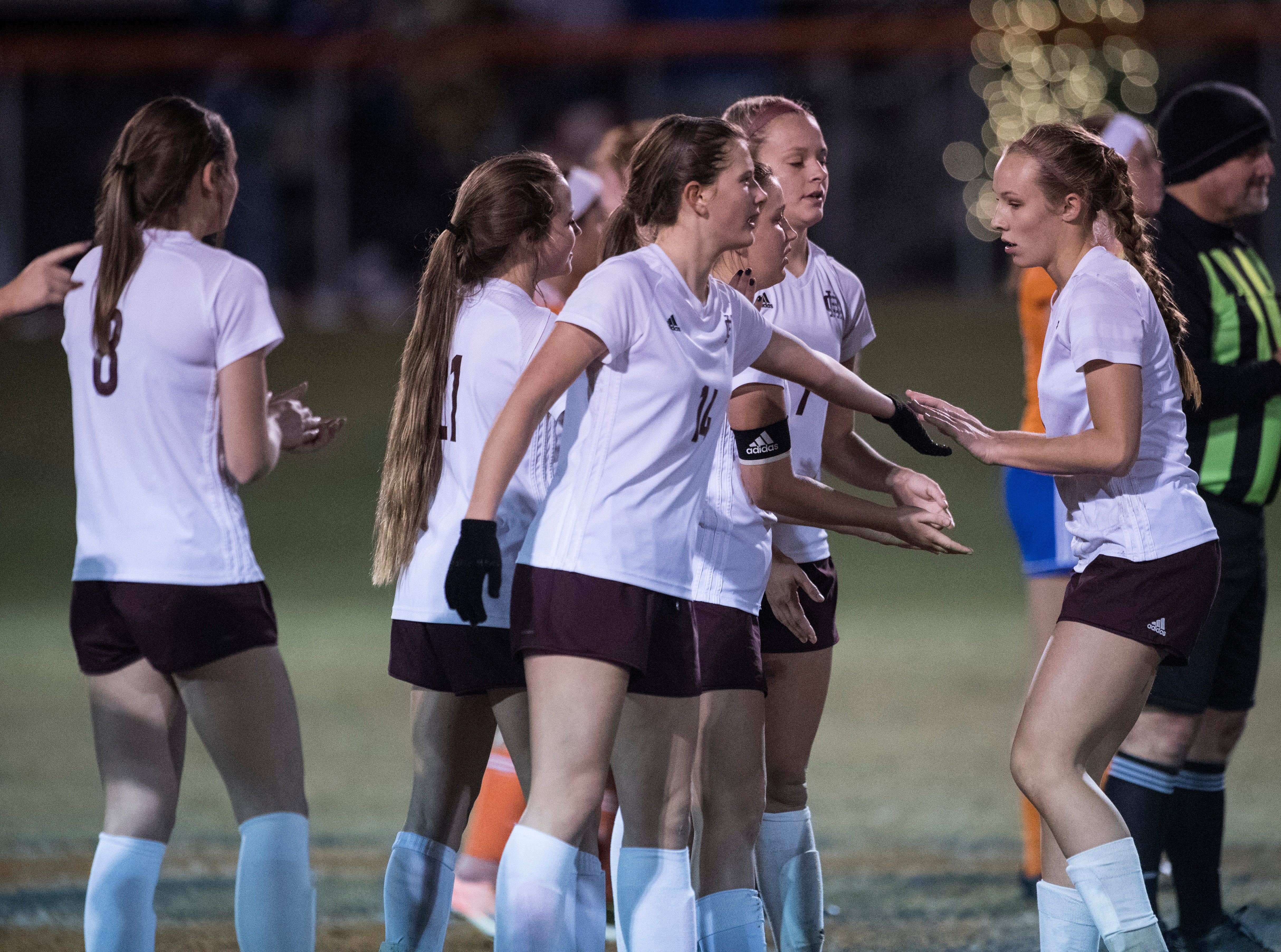 Henderson County celebrate after Maddie Griggs's penalty kick is successful in sudden death during the first round of the KHSAA state tournament at Marshall County High School Monday, Oct. 23, 2018.
