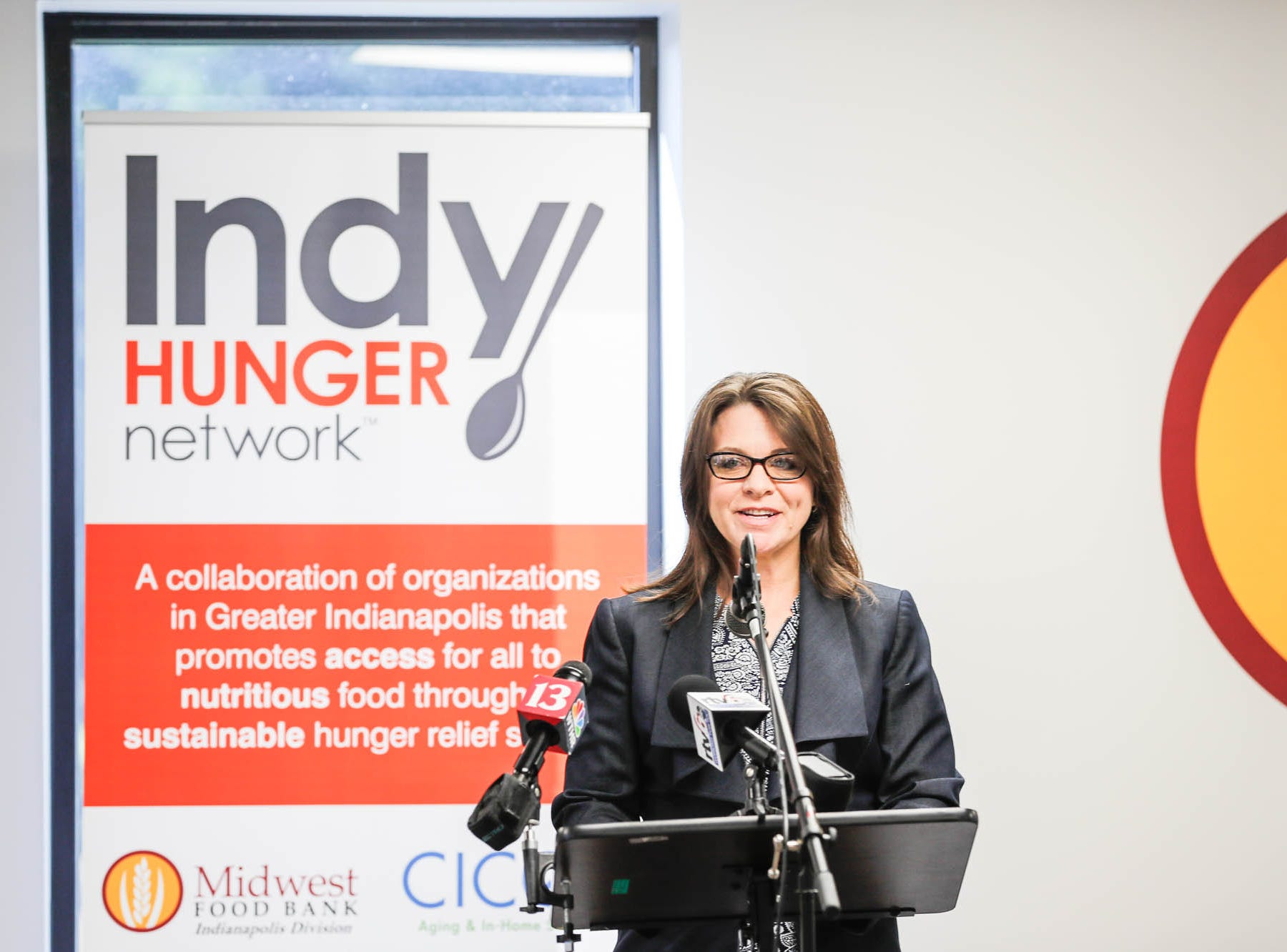 Indiana Motor Truck Association Vice President, Barbara Hunt, speaks during a press conference announcing the expansion of the Food Drop program, which partnered with Indiana's largest hunger relief agencies to make it easier for truck drivers to donate store-rejected food on Tuesday, Oct. 23, 2018.