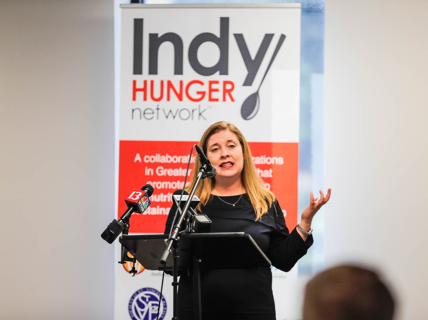Emily Weikert Bryant, the executive director of Feeding Indiana's Hungry speaks during a press conference announcing the expansion of the Food Drop program, which partnered with Indiana's largest hunger relief agencies to make it easier for truck drivers to donate store-rejected food on Tuesday, Oct. 23, 2018.