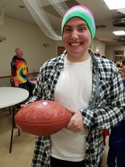 Show choir standout Austin Hewitt received an autographed football from Colts quarterback Andrew Luck -- a big fan of the arts.