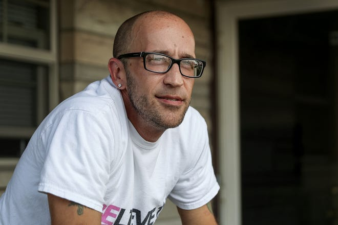 "Tyson Timbs poses for a portrait at his aunt's home in Marion, Ind., Monday, Aug.13, 2018. Five years ago, Timbs had his $42,000 Land Rover taken by the government in a process known as ""civil asset forfeiture,"" after he pled guilty to selling $260 of heroin. Lawyers for Timbs and the State of Indiana will argue whether Eighth Amendment protection from ""excessive fines"" applies to civil forfeitures at the state level, in front of the U.S. Supreme Court on Nov. 28, 2018."