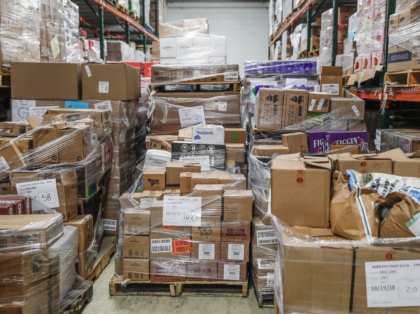 Food stuffs are stacked and sorted at the Midwest Food Bank after a press conference announcing the expansion of the Food Drop program, which partnered with Indiana's largest hunger relief agencies to make it easier for truck drivers to donate store-rejected food on Tuesday, Oct. 23, 2018.
