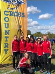 Team photo: From left, Elizabeth Stanhope, Bella Hodges, Jessica Velez, Nia Taylor, Sophia Thibault, Katelin Schwab. Kneeling is Cara Karmolinski.
