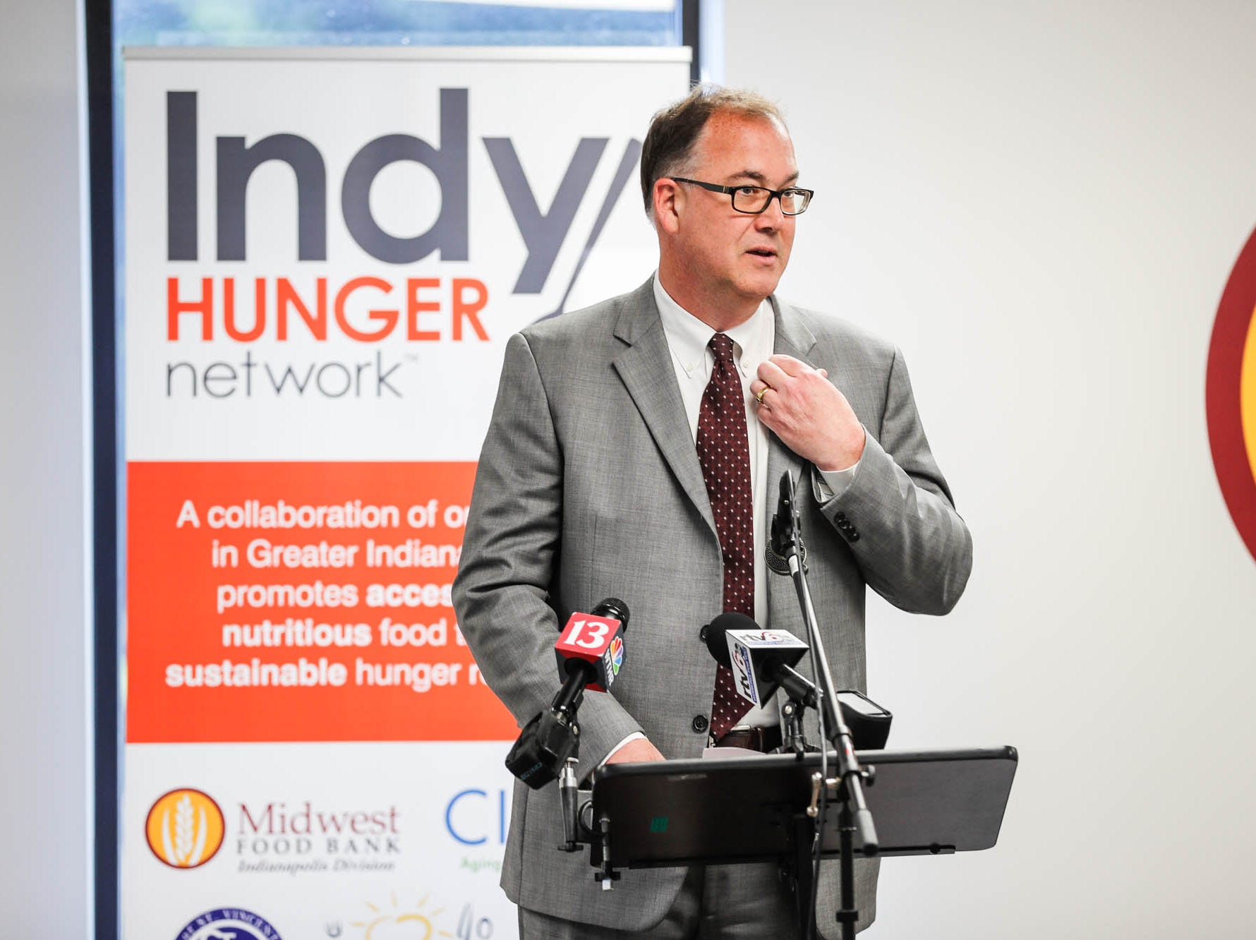 President/CEO of Gleaners Food Bank, John Elliott, speaks during a press conference announcing the expansion of the Food Drop program, which partnered with Indiana's largest hunger relief agencies to make it easier for truck drivers to donate store-rejected food on Tuesday, Oct. 23, 2018.