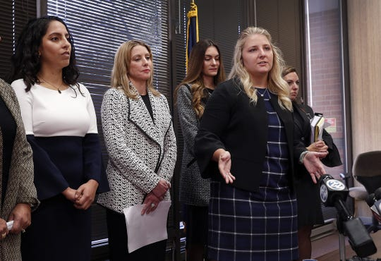 Gabrielle McLemore, one of the four women accusing Curtis Hill of sexual harassment, speaks to the media. Dan Sigler, the special prosecutor investigating allegations against against Attorney General Curtis Hill, announced that he will not pursue charges against Hill during a press conference Tuesday, Oct 23, 2018.