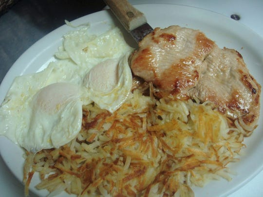 Get a grilled pork chop or corned beef hash with eggs and hash browns with a side of ghost stories at Erika's Place in Westfield.