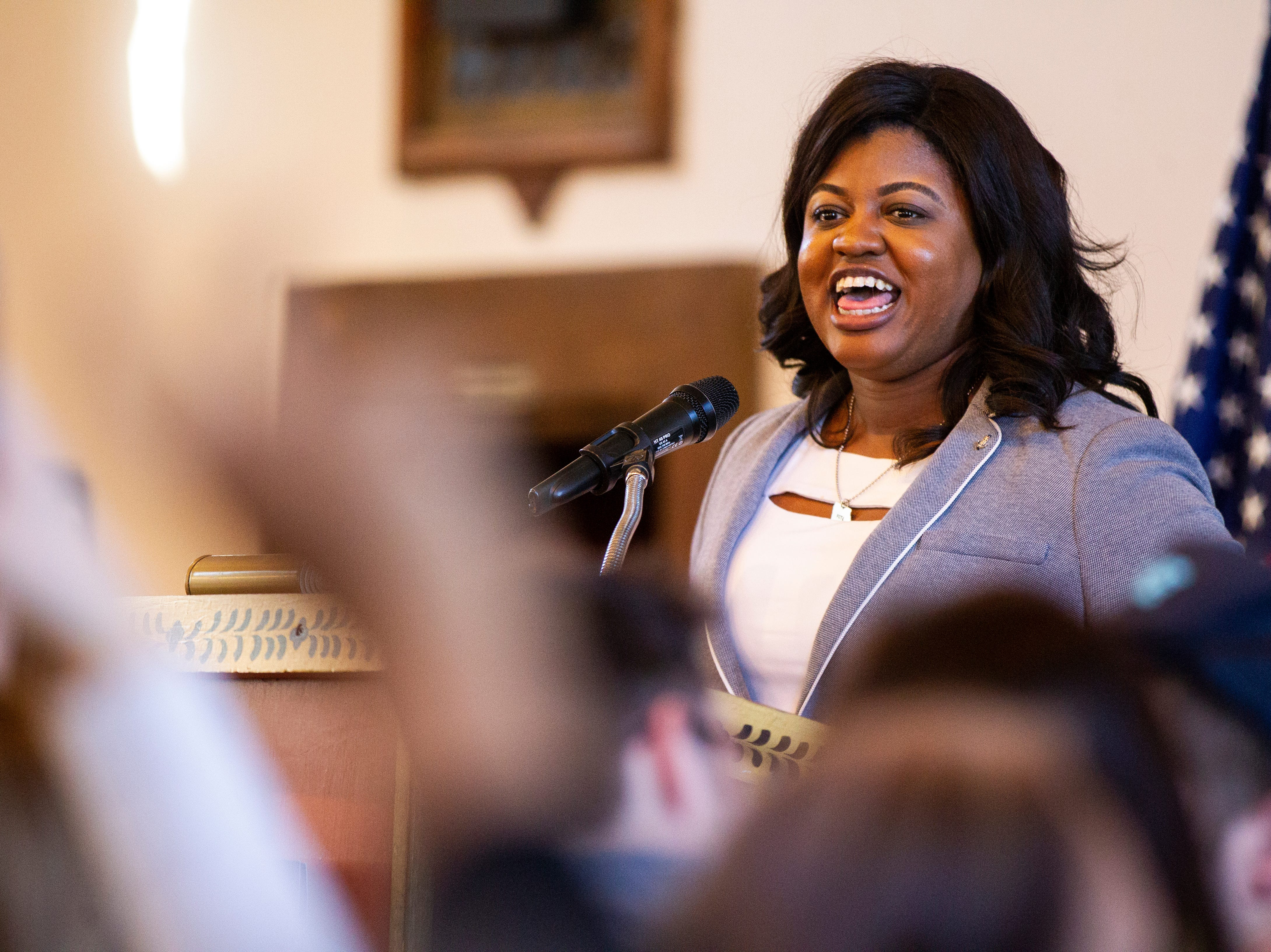 """Deidre DeJear, Iowa Secretary of State candidate, speaks during a """"All Hands on Deck"""" event on Tuesday, Oct. 23, 2018, at Old Brick in Iowa City."""