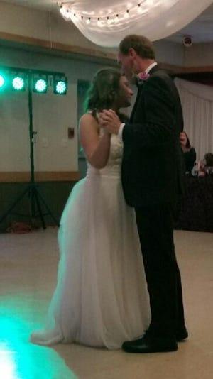 North Carrollton Mayor Ken Strachan dances with his daughter, Kate, at her wedding in Baldwinsville, New York.