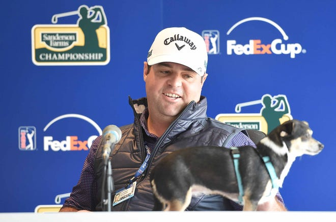 Jonathan Randolph speaks to media with his dog, Yodi, on Tuesday, October 23, 2018, at the Sanderson Farms Championship at the Country Club of Jackson in Jackson, Miss.