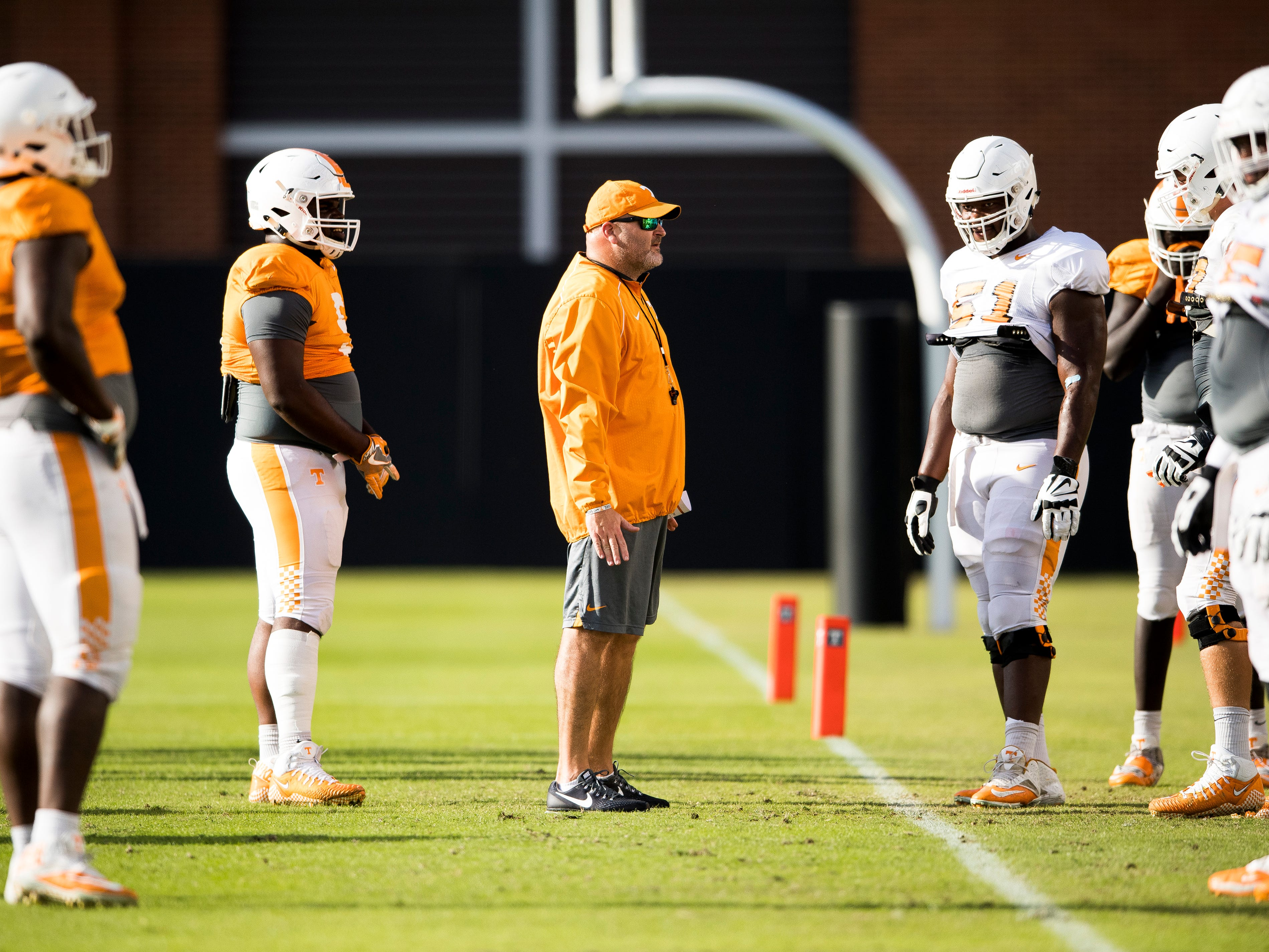 Tennessee offensive line coach Will Friend, center, during Tennessee's afternoon football practice on campus on Tuesday, October 23, 2018.