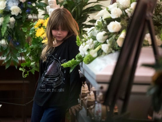 "Natalie Brown stands by her older sister, Angelina ""Gia"" Givens' casket during her services at Berry Lynnhurst Funeral Home on Monday, October 22, 2018. The 16-year-old, former Gibbs High School student died by suicide on the school grounds on October 18."