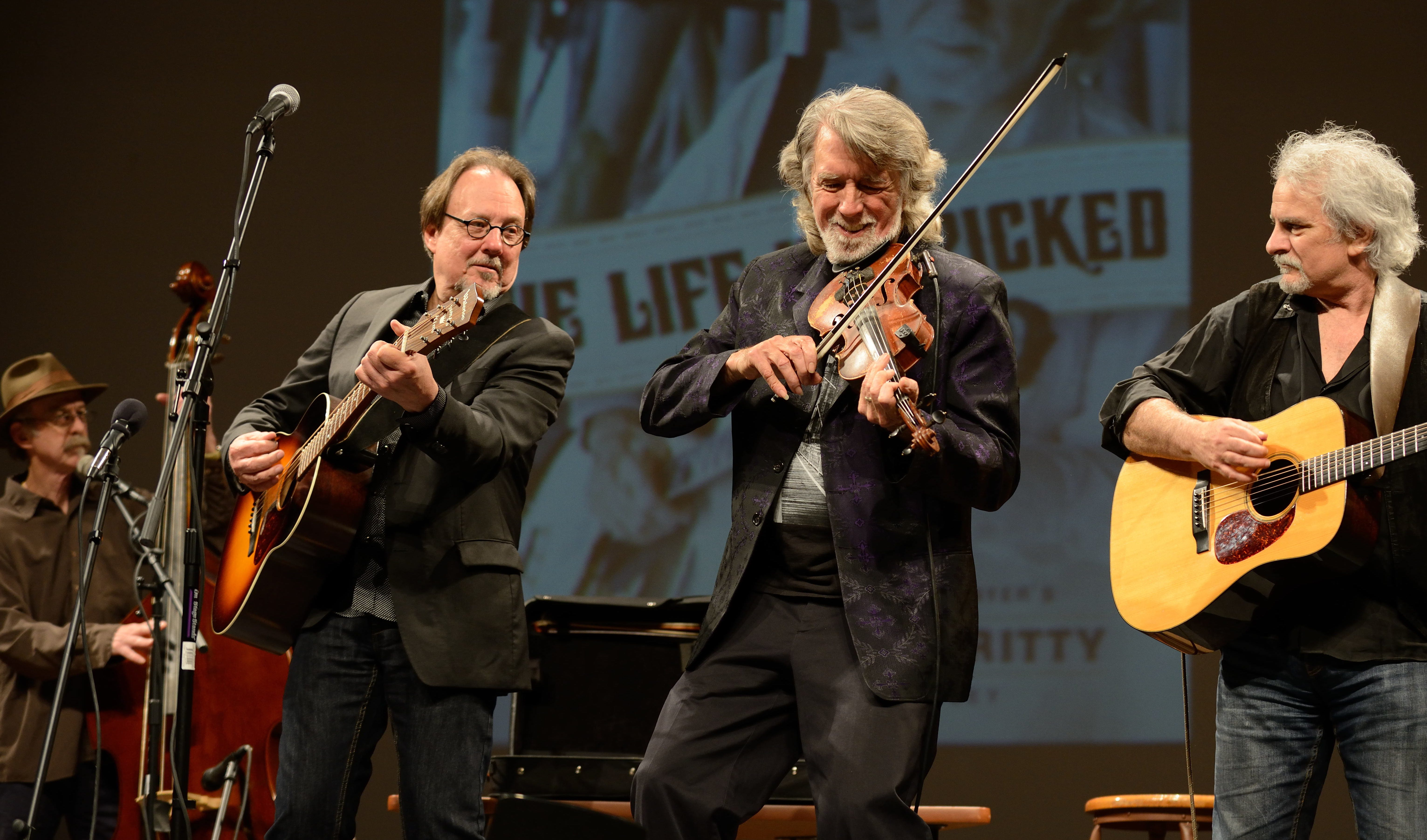 John McEuen, second from right, also plays guitar, banjo and mandolin in addition to the fiddle.