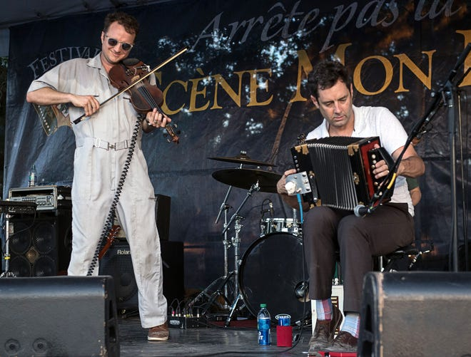 Brothers Louis, left, and Andre Michot of the Lost Bayou Ramblers are shown on stage at the 2018 Festivals Acadiens et Creoles in Girard Park.