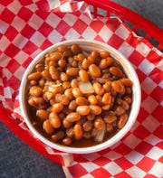 FireFresh Southern Kitchen's baked beans made with navy beans, diced onions, sweet and spicy barbecue sauce and brown sugar.