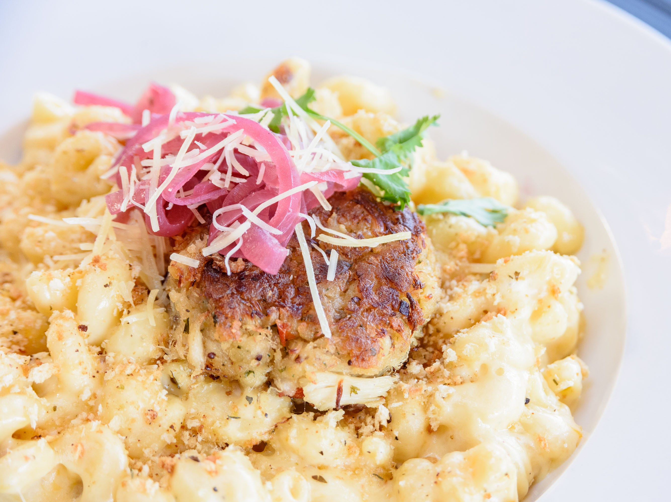 Mac N Chz with Pickled Red Onion and Crab Cake at The Manhattan Project at 2101 Frankfort Ave. Oct. 18, 2018