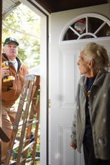 Former Ingham County Sheriff Gene Wriggelsworth, a volunteer with Tuesday Toolmen, works on a new door installation for Lois Faggion, Tuesday, Oct. 23, 2018.  Since the LSJ published a story on the rat problem, a number of people in the community have stepped forward to help the 87-year-old out.