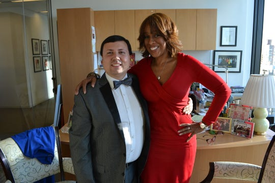 "Xavier DeGroat in an undated photo with Gayle King, co-anchor for ""CBS This Morning,"" and editor-at-large for O,  The Oprah Winfrey Magazine."