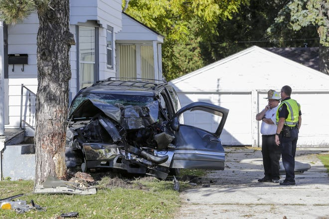 The scene of a car crash in the 1600 block of Marshall Street Tuesday, Oct. 23, in Manitowoc.
