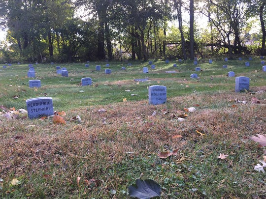 Stone markers at a Manitowoc cemetery.