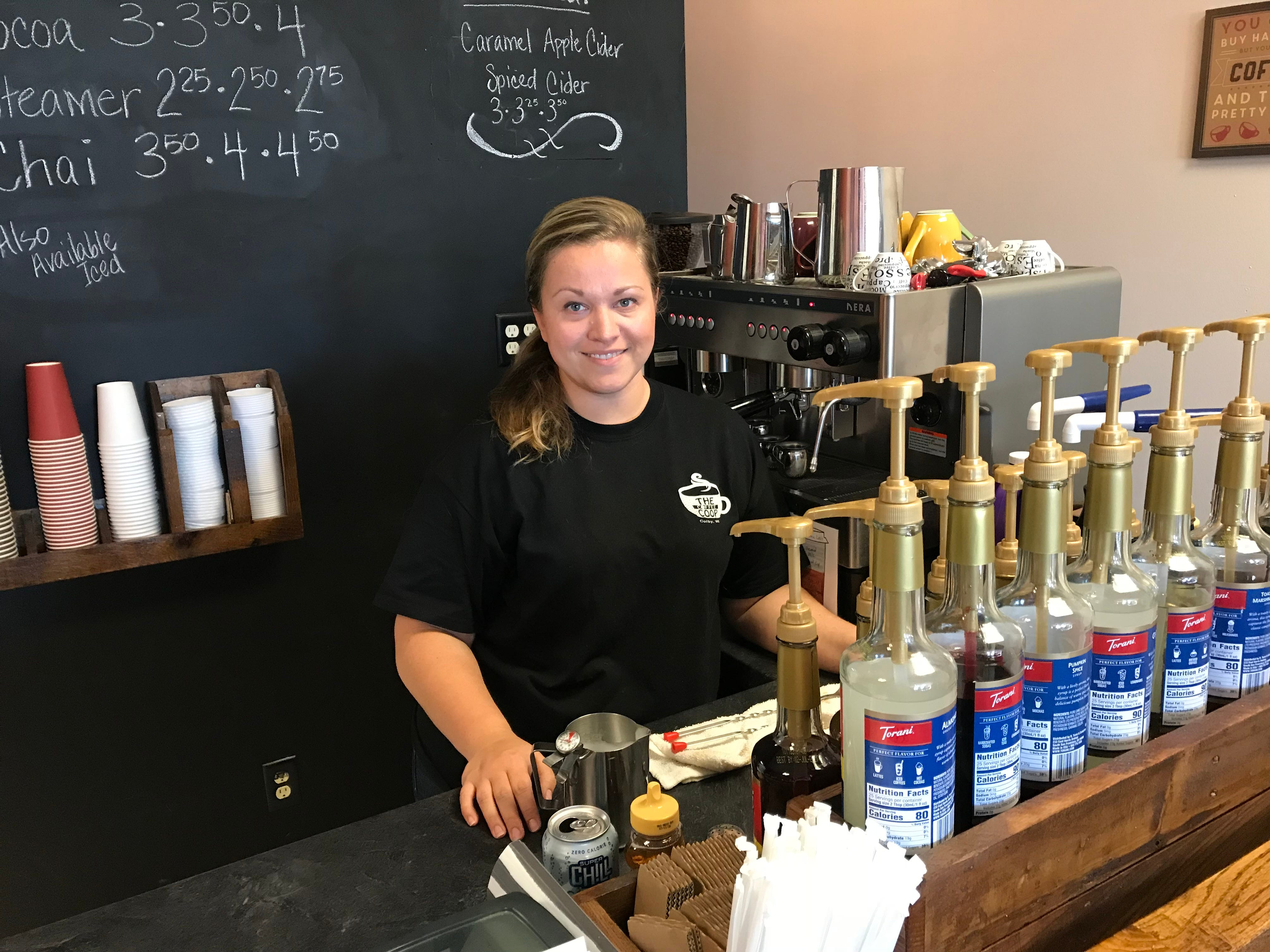 Ariel Oehmichen gets set to make a cup of coffee at The Coffee Coop in Colby.